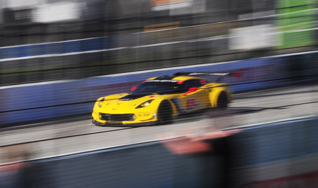 Image of yellow race car fueled by SEO and racing ahead of the competition